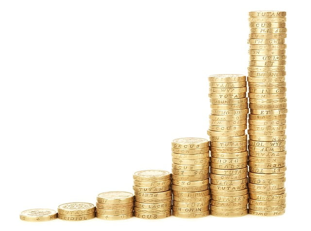 coins representing a business that starts low but yield its highest potential profits